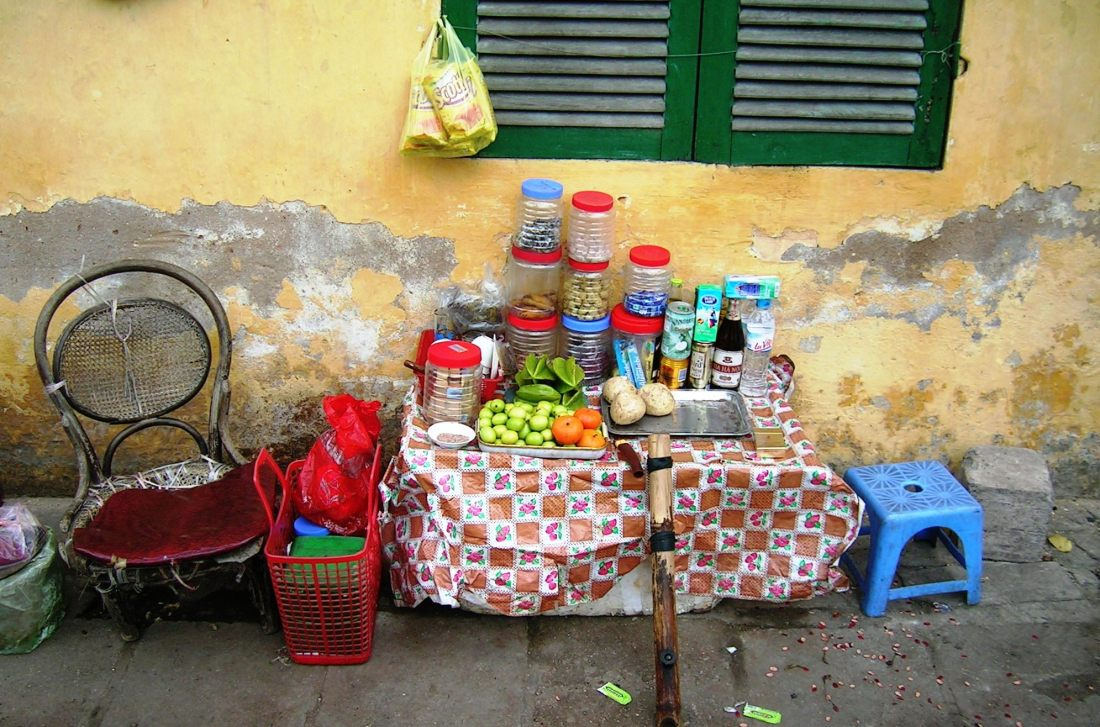 Long days, day after day, even the street vendor sometimes needs a break....time out in North Vietnam