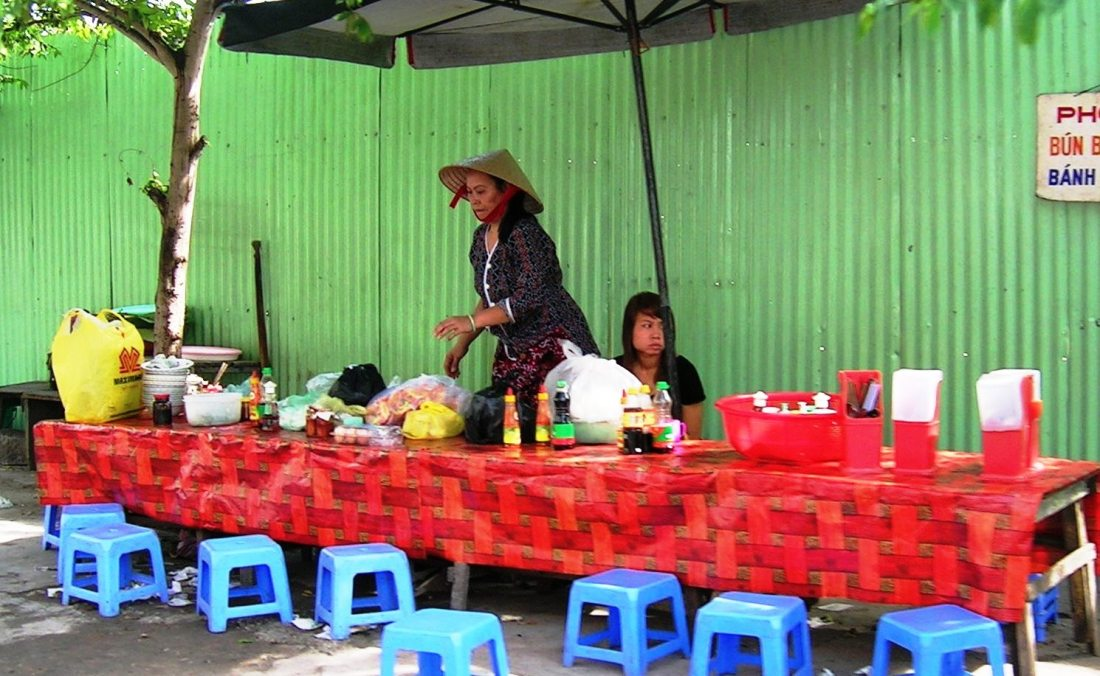 Mother and daughter, two generations of street vendors, preparing for along day ahead - Vietnam