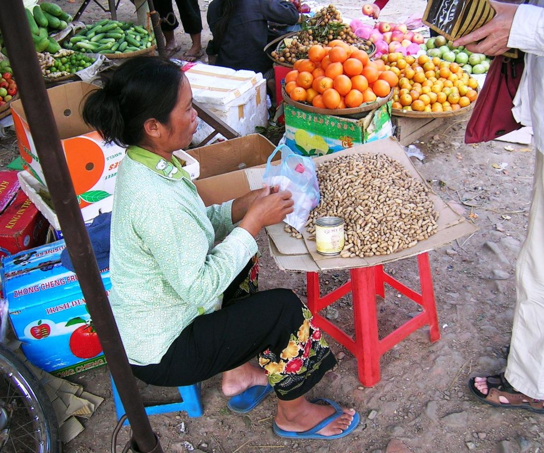 Selling peanuts on the streets of Phnom Pen - and earning peanuts too....