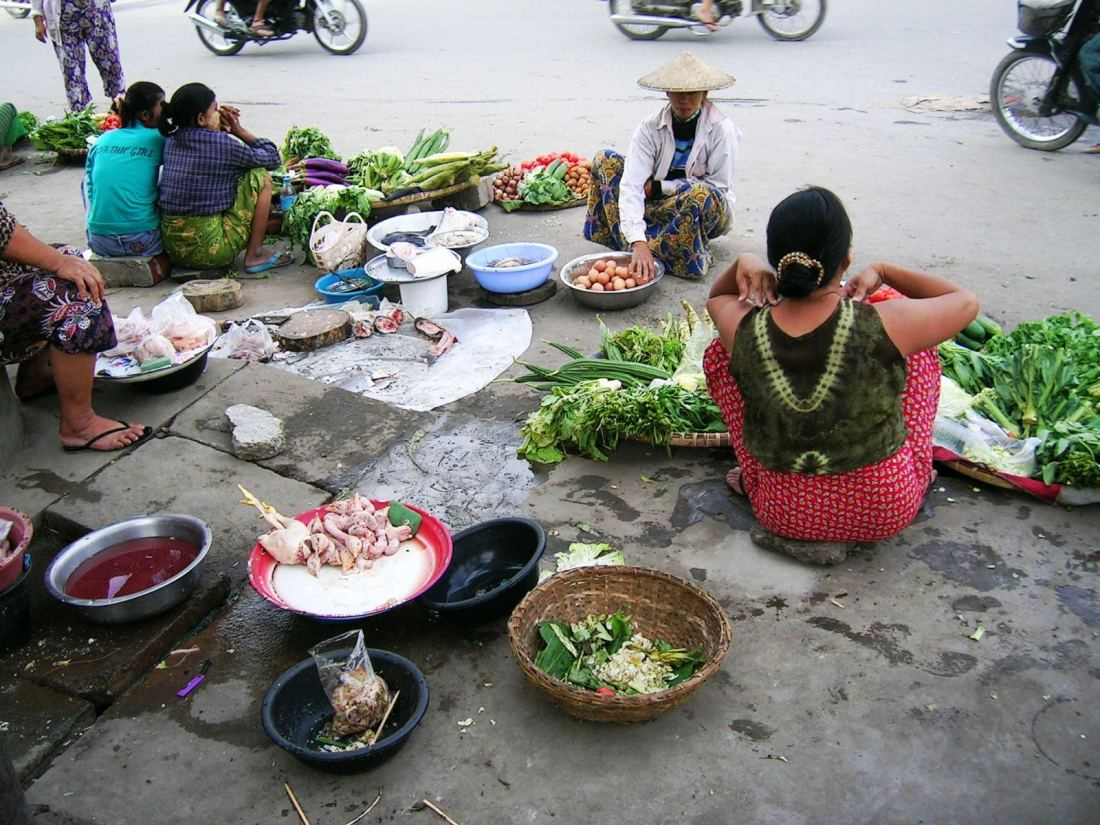 These women will sit on their haunches all day....streets of Mandalay, Mynamar
